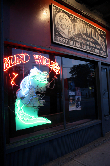Blind Willie's at dusk. The guitar neon toting gator is a recognizable image on Atlanta's Highland Avenue.