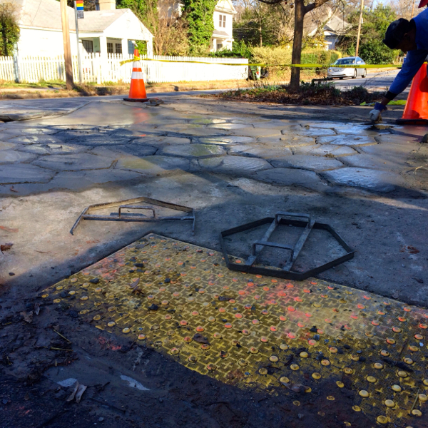 Sidewalk repair. Atlanta's Candler Park neighborhood, Dec. 2013. Photo by author.