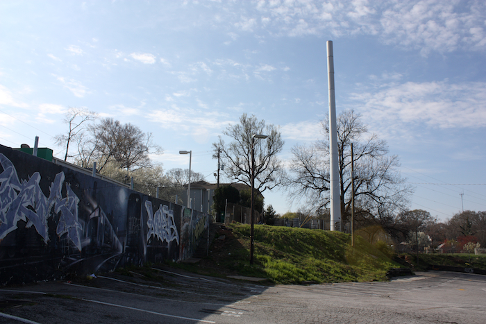 "This tower on Moreland Ave. in Atlanta's Little 5 Points commercial district was built after two rounds of Section 106 consultation that began in 2004. The proposed facility was determined to adversely affect multiple properties listed in and eligible for listing in the National Register of Historic Places. Section 106 consultation concluded which memorialized mitigation by constructing a ""stealth"" tower to reduce visibility and the telecommunications company funded the production of a narrative history of the Little 5 Points Commercial District."