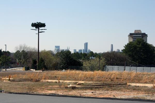 A monopine is juxtaposed against Atlanta's skyline in DeKalb County, Ga. Photo by author, 2011.