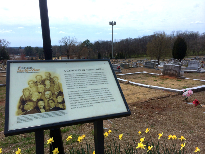 Communications tower seen in the background of a Southview Cemetery interpretive sign. Photo by author, March 15, 2014.