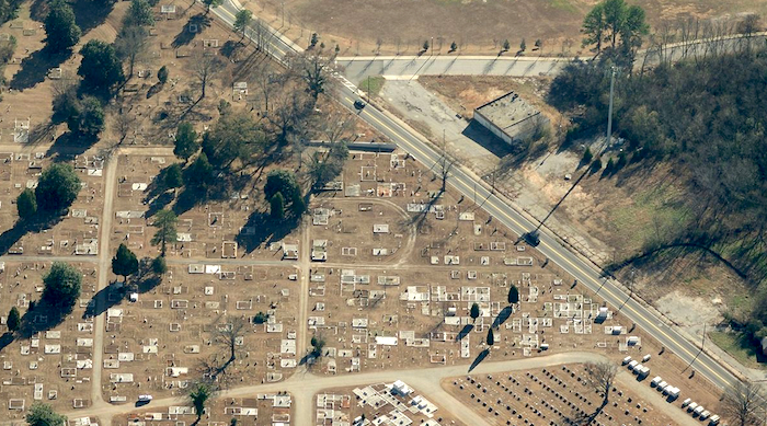Oblique aerial photo showing the communications tower (right) and the shadow it casts across Jonesboro Road towards the cemetery (left). Photo credit: Bing Maps.