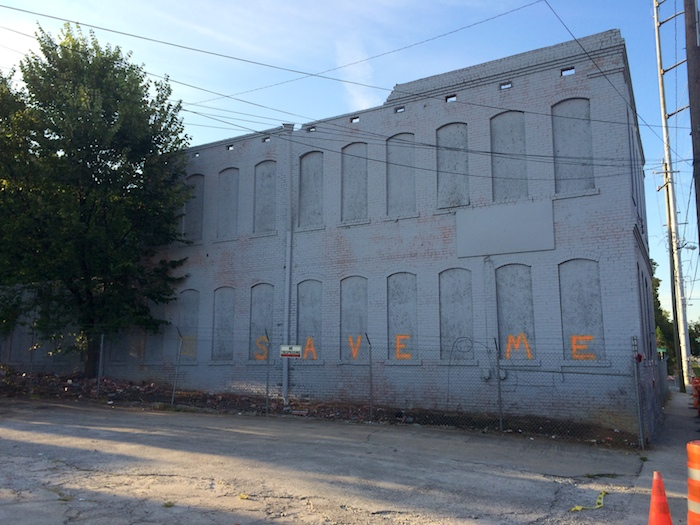 "North Facade with ""Save Me"" written across, Aug. 2014."