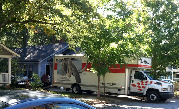 An Oakhurst family moving out of the neighborhood in October 2011.