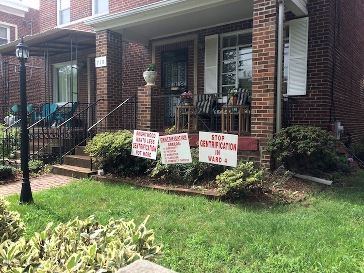 Anti-gentrification signs in Washington yard. Photo by author.