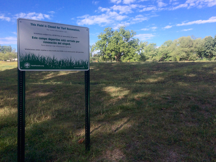 Bilingual signs provide information on the new soccer field completed in 2015.