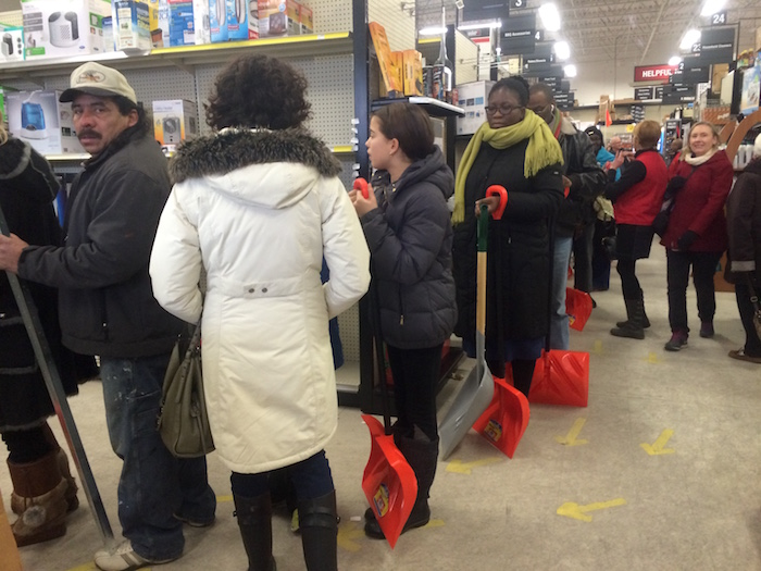 Everyone in line at the Strosnider's hardware store in Silver Spring had a snow shovel. The checkout line snaked around the entire store interior.