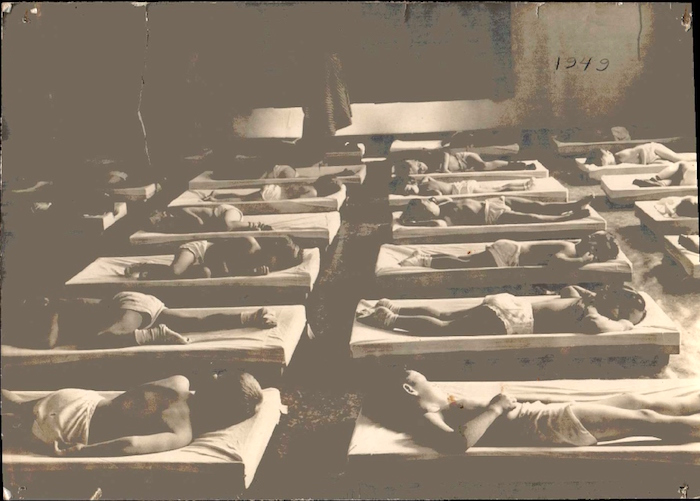 Nap time. Kendall children sewed the sheets for the cots for spending money. Photo courtesy of Kaye Giuiliani.